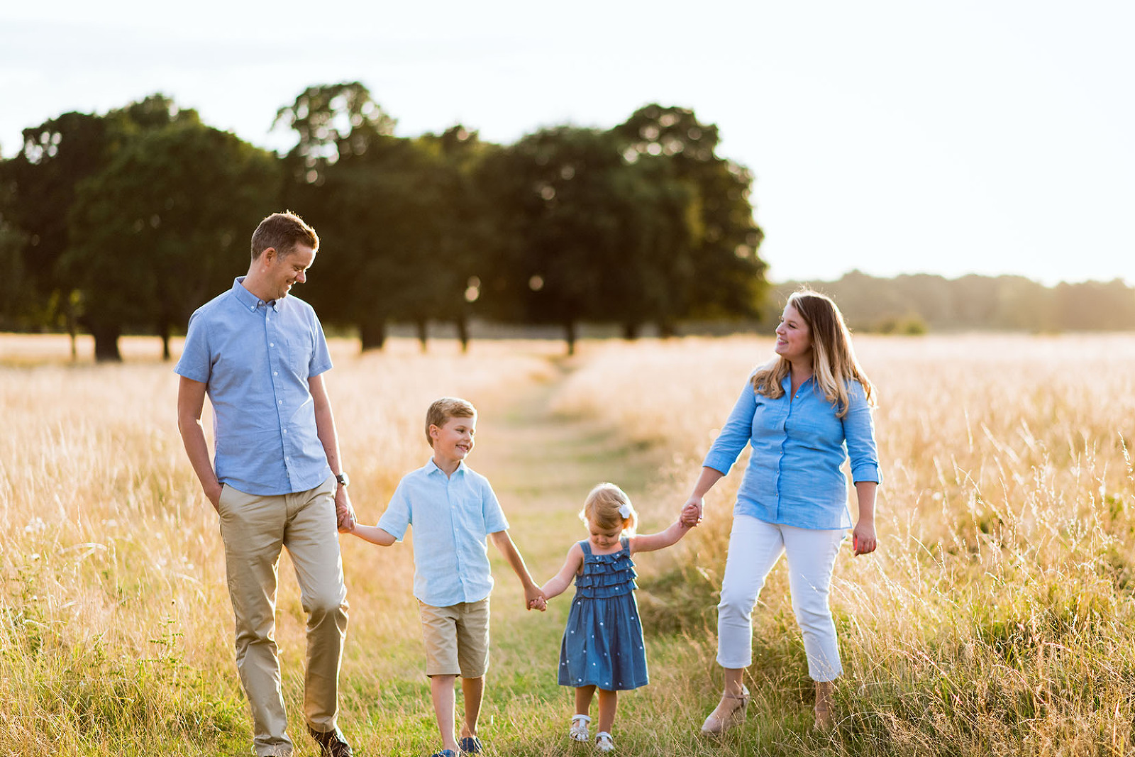 Family smiling together in summer photo shoot Esher
