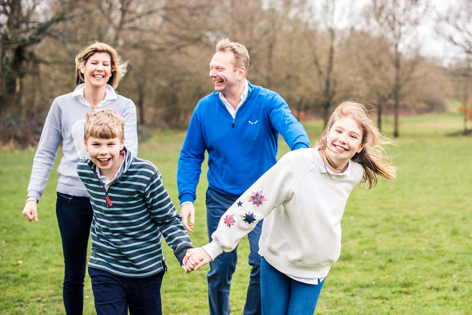 Family running together on photo shoot