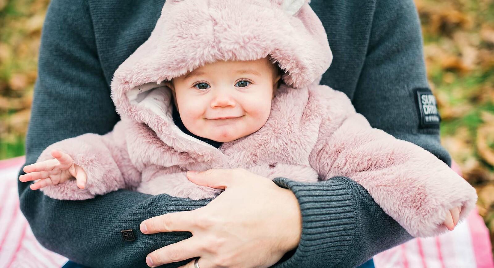 Baby smiling during family photo shoot Farnham