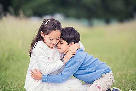 Brother hugging sister in photo shoot Surbiton