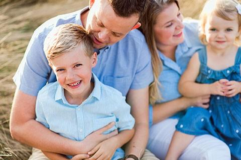 Family hugging during photo shoot Richmond