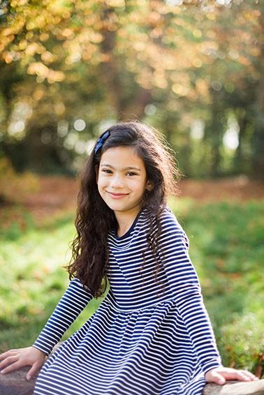 Girl smiling during photo shoot Epsom