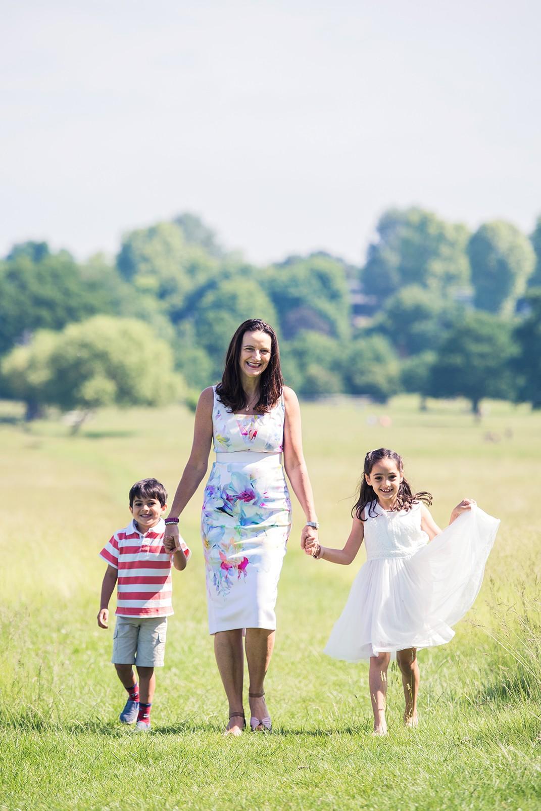 Mother and children walking on photo shoot in Twickenham