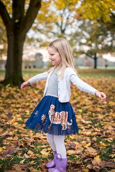 Girl dancing in autumn on photo shoot in Epsom