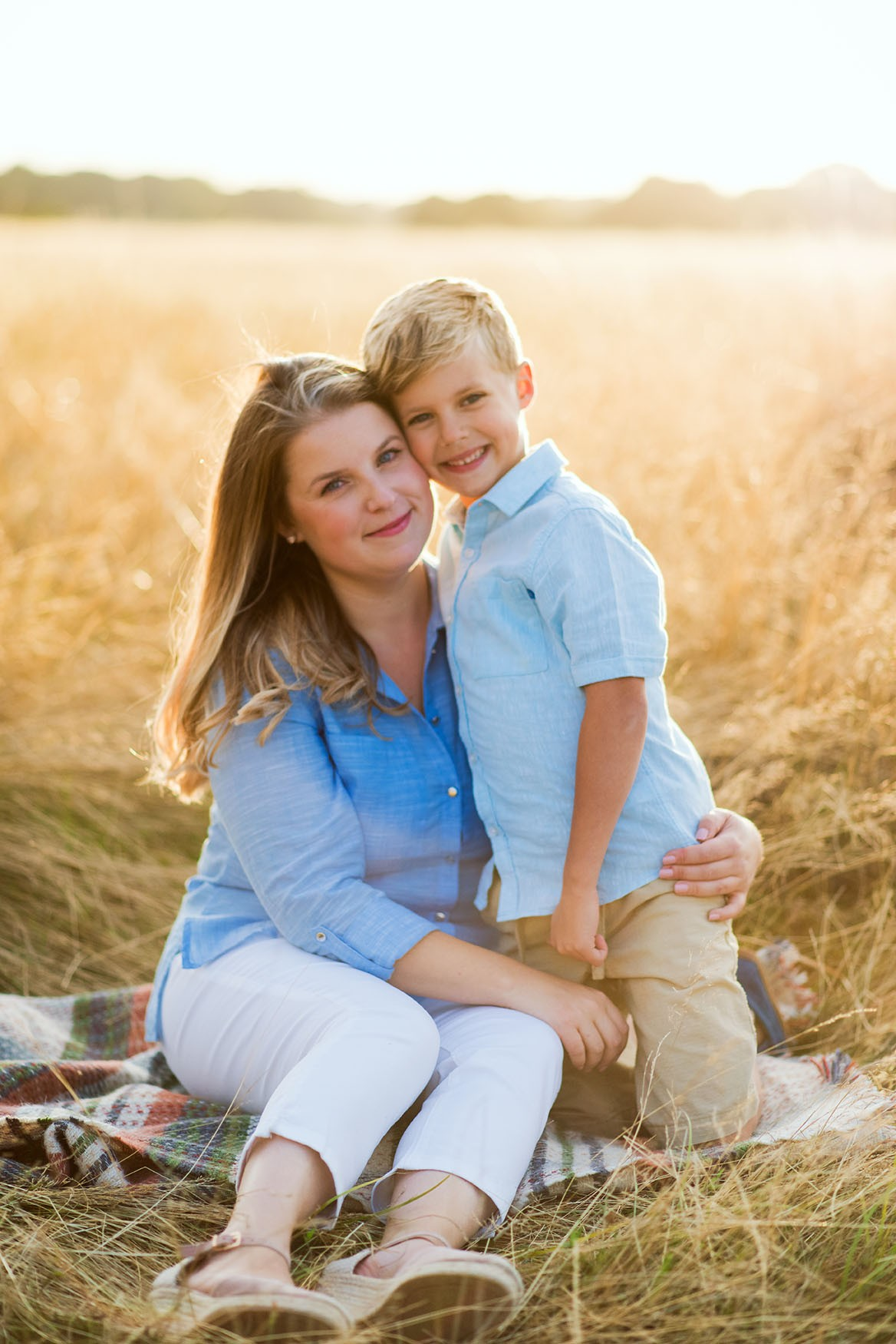 Mother and son hugging in golden hour photo shoot