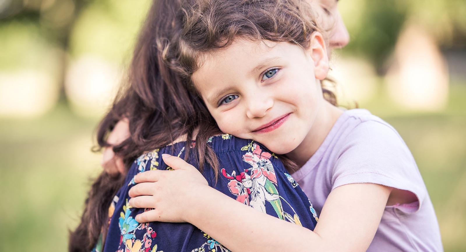 Girl hugs her mum on photo shoot Twickenham