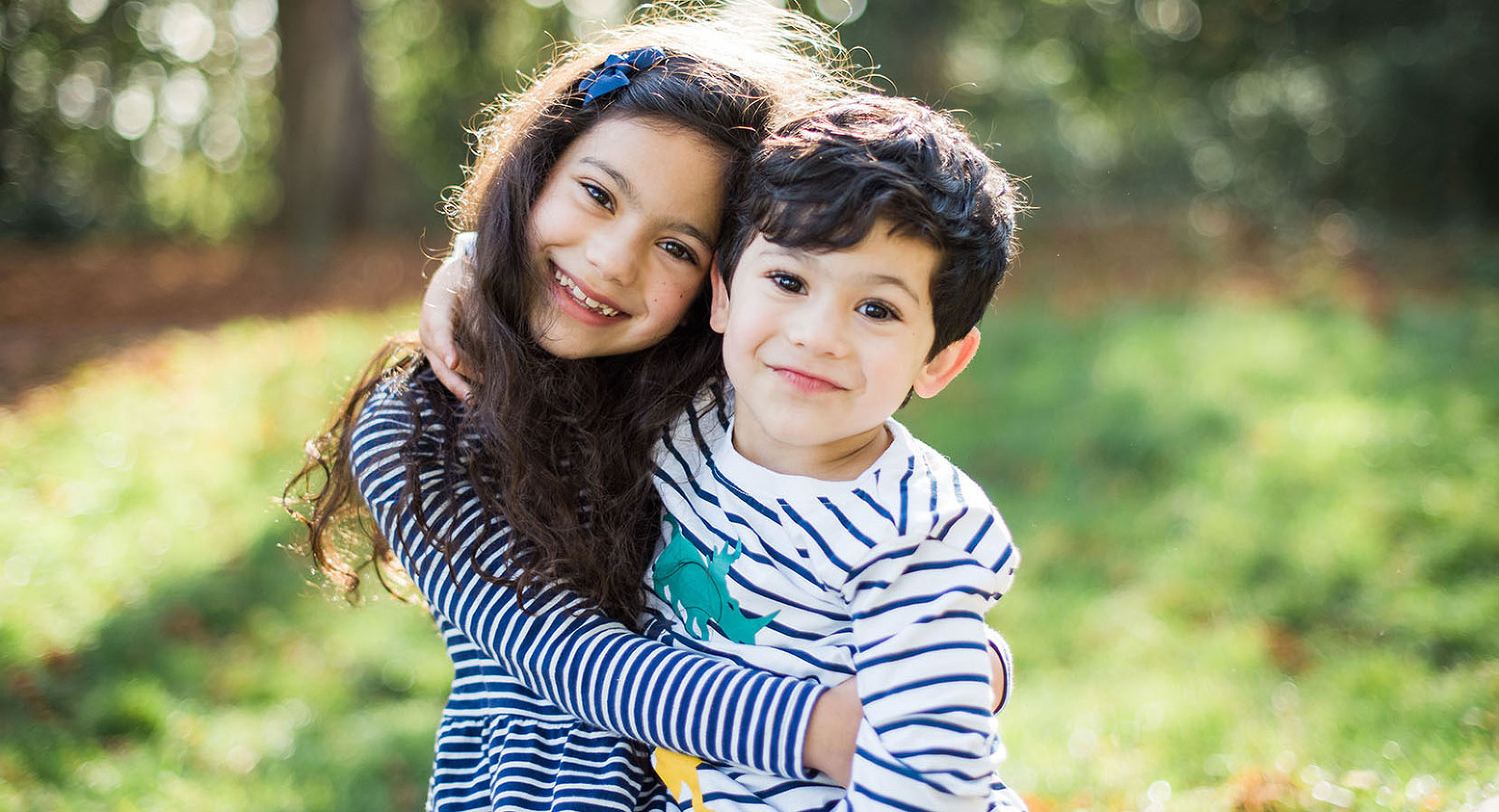 Brother & sister hugging on photo shoot in Haslemere
