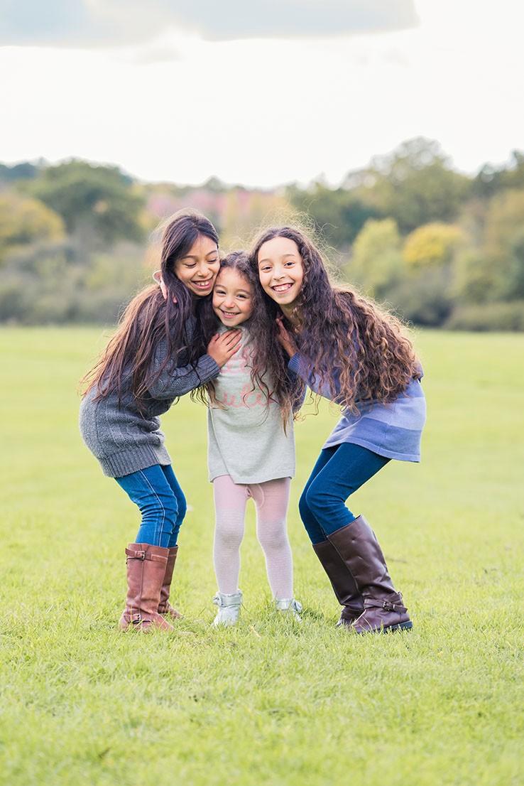 Sisters hugging on photo shoot in Epsom