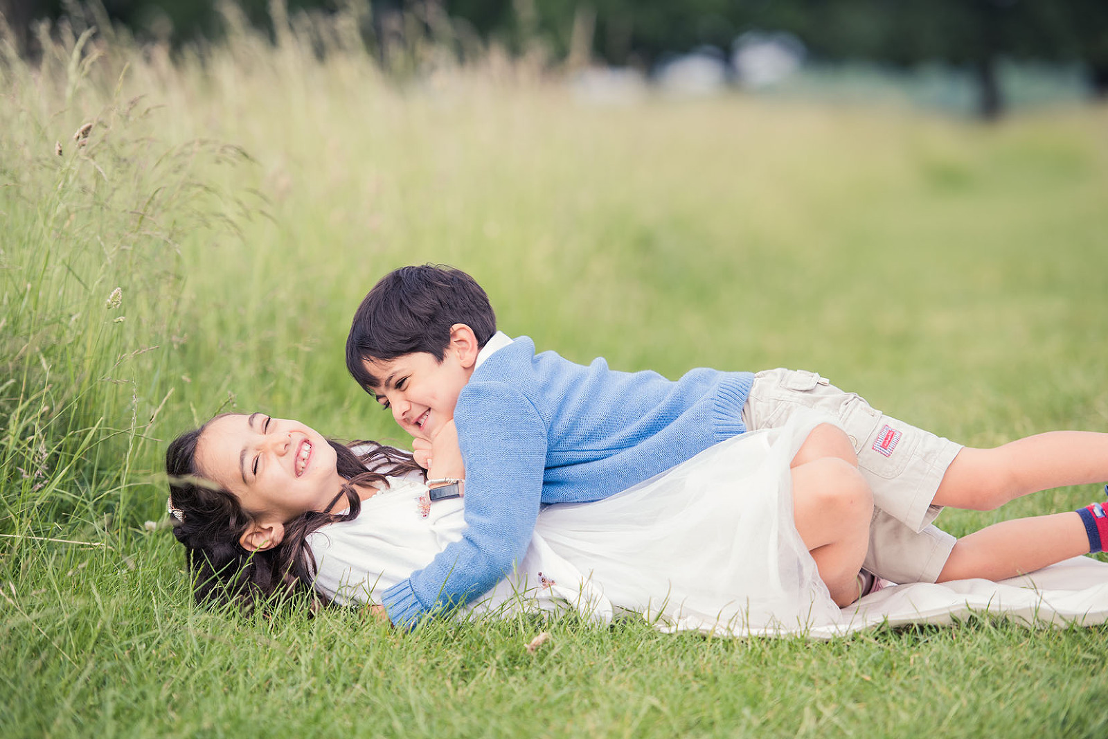 Brother & sister laughing on photo shoot Surrey