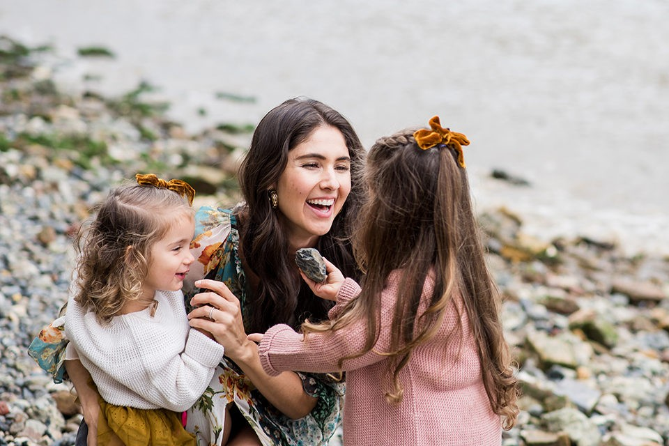 A family smiling on a London vacation photo shoot