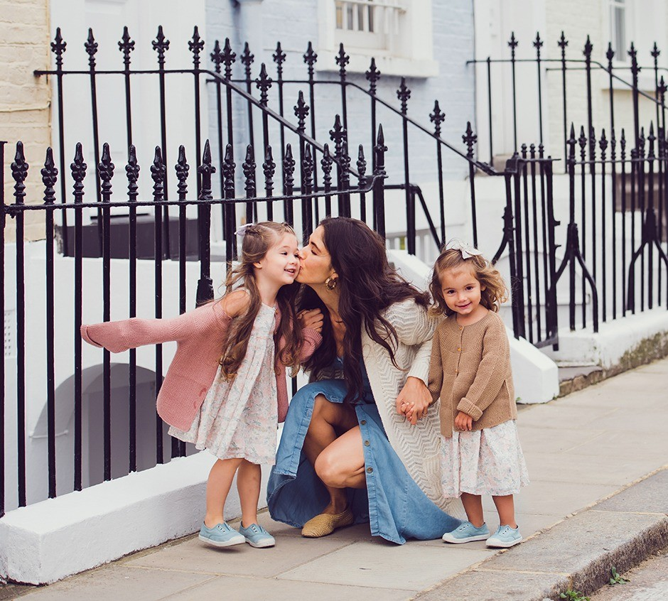 A mum kissing her daughter in Notting Hill