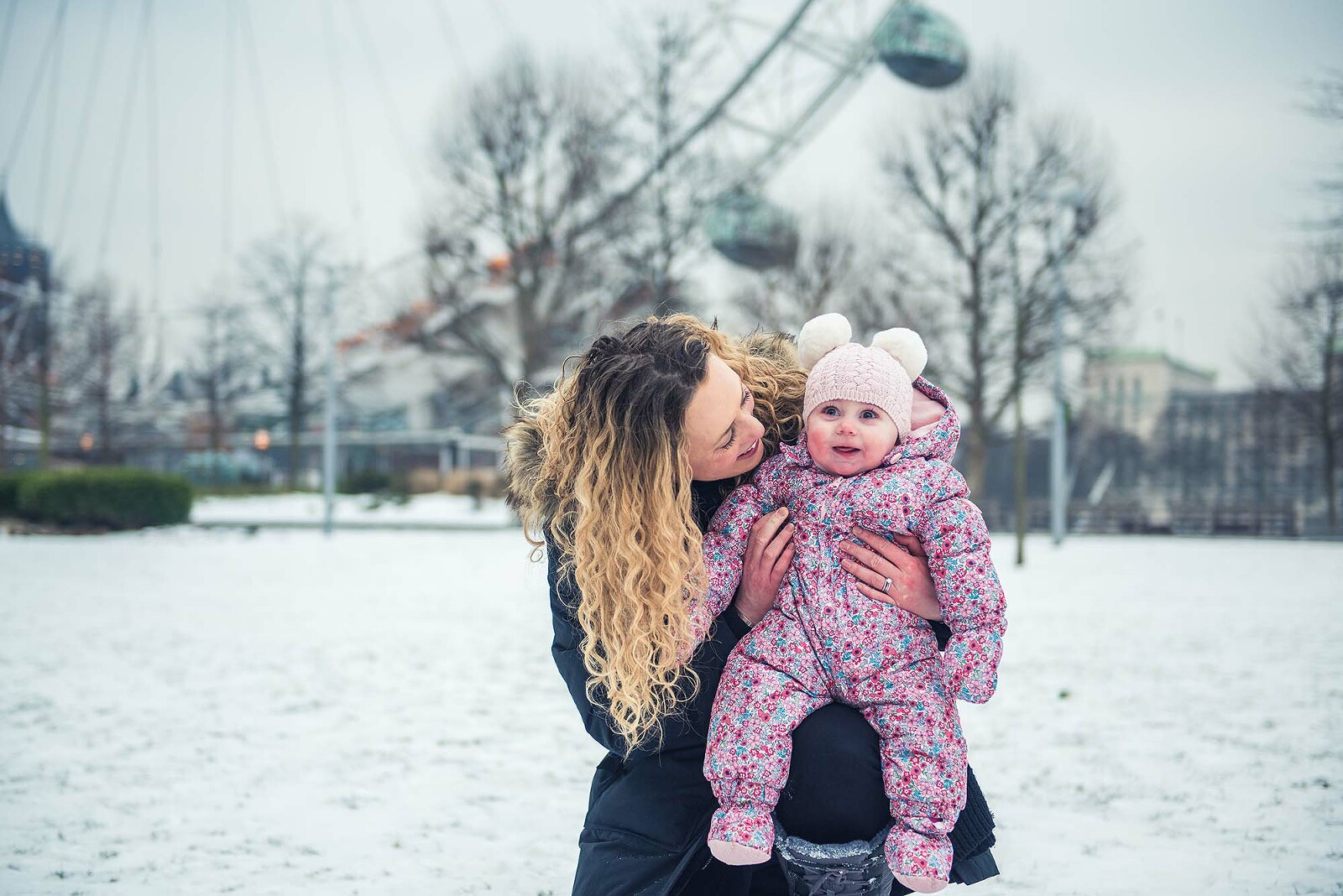 Baby seeing her first snow at Southbank London photo shoot
