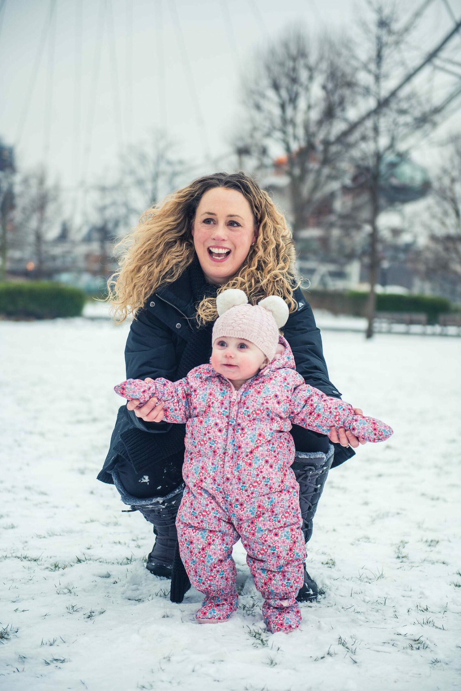 Happy family photography in the snow in London Southbank